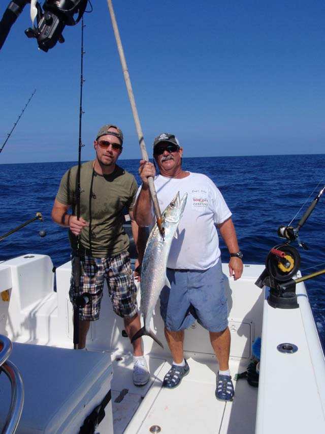 A happy fisherman with a Kingfish caough aboard the Goin Off fishing out of Port Canaveral, Florida
