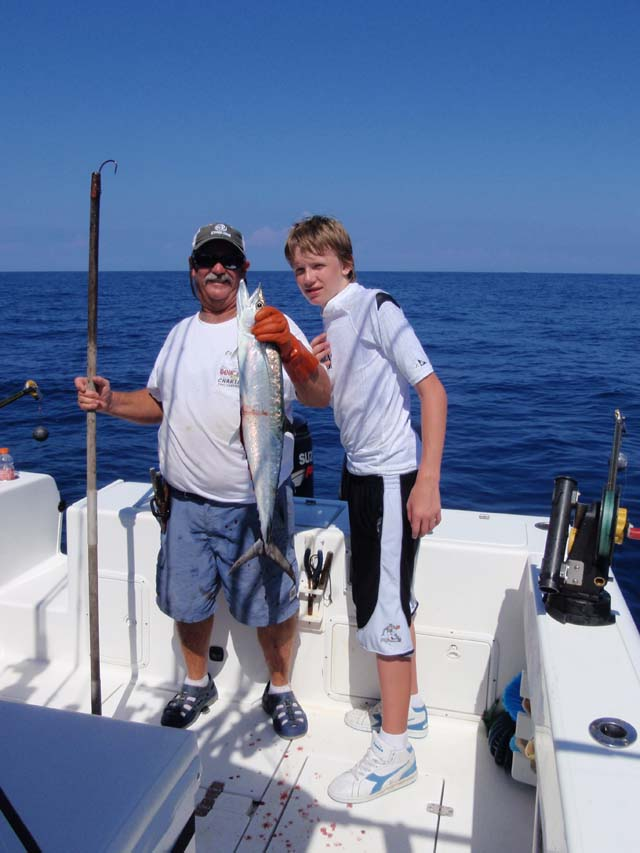 A happy kid with a Kingfish caught aboard the Goin Off fishing out of Port Canaveral, Florida