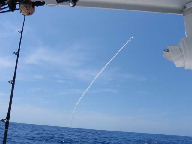 A shuttle launch viewed while deep sea fishing aboard the Goin Off out of Port Canaveral near Cocoa Beach